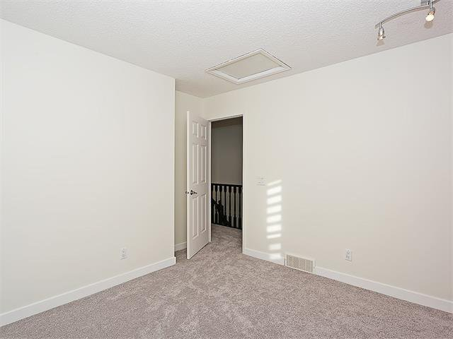Photo 35: Photos: 208 COACHWAY Lane SW in Calgary: Coach Hill House for sale : MLS®# C4092510