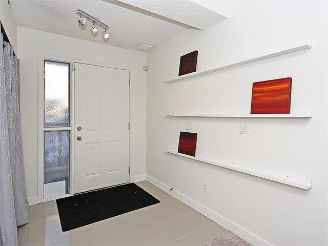 Photo 5: Photos: 208 COACHWAY Lane SW in Calgary: Coach Hill House for sale : MLS®# C4092510
