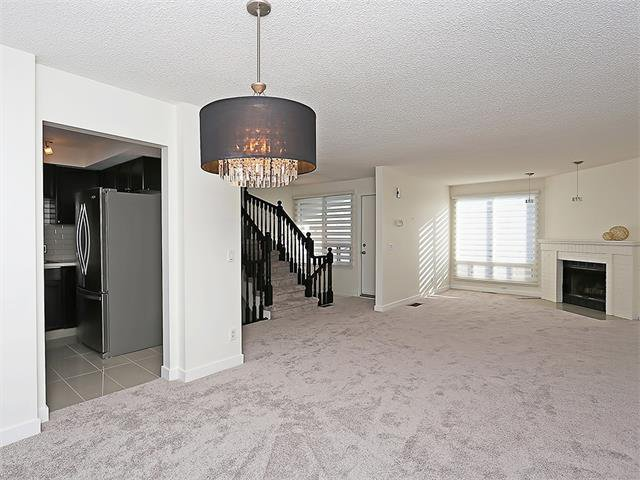 Photo 8: Photos: 208 COACHWAY Lane SW in Calgary: Coach Hill House for sale : MLS®# C4092510