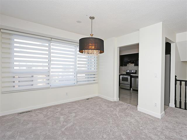 Photo 17: Photos: 208 COACHWAY Lane SW in Calgary: Coach Hill House for sale : MLS®# C4092510