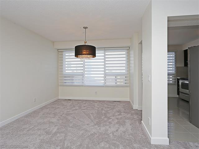 Photo 19: Photos: 208 COACHWAY Lane SW in Calgary: Coach Hill House for sale : MLS®# C4092510