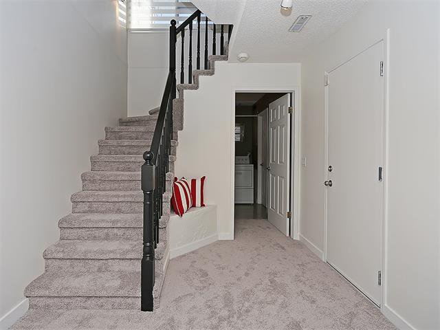 Photo 6: Photos: 208 COACHWAY Lane SW in Calgary: Coach Hill House for sale : MLS®# C4092510