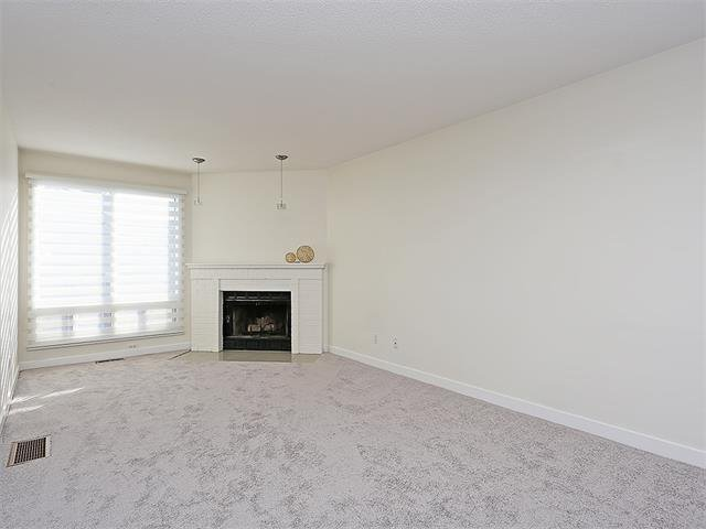 Photo 22: Photos: 208 COACHWAY Lane SW in Calgary: Coach Hill House for sale : MLS®# C4092510