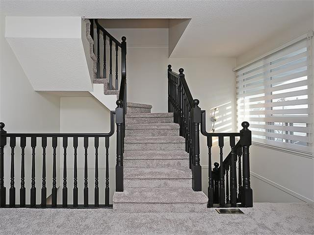 Photo 20: Photos: 208 COACHWAY Lane SW in Calgary: Coach Hill House for sale : MLS®# C4092510