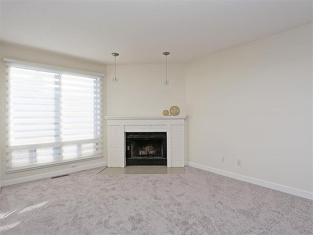Photo 23: Photos: 208 COACHWAY Lane SW in Calgary: Coach Hill House for sale : MLS®# C4092510