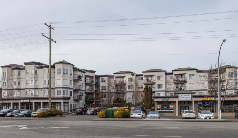 """Main Photo: 418 5759 GLOVER Road in Langley: Langley City Condo for sale in """"College Court"""" : MLS®# R2026481"""