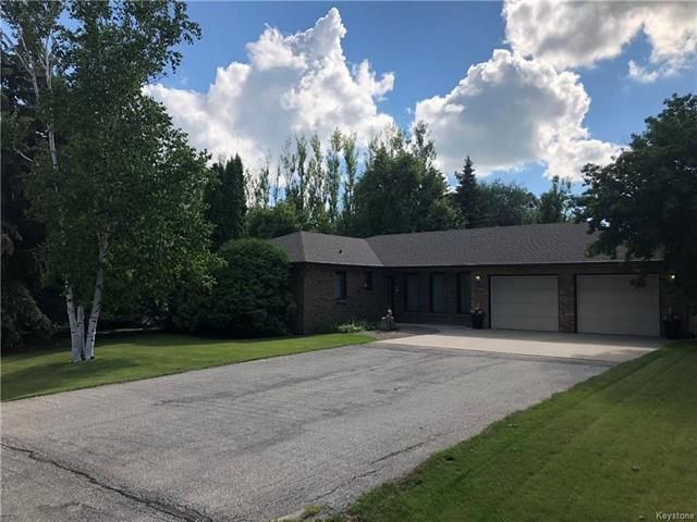 Great curb appeal, drive into large 26x24 garage.