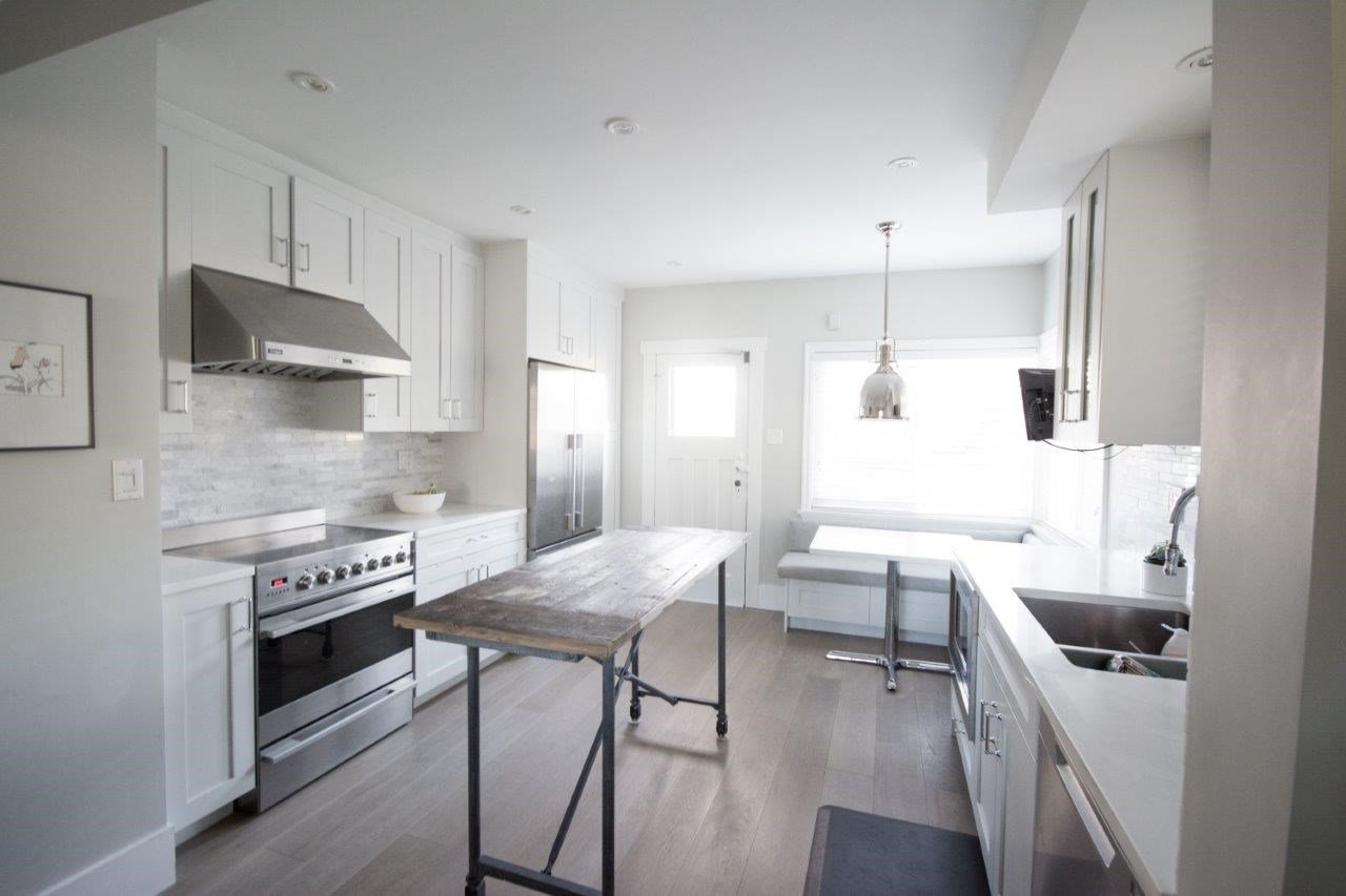 Fisher and Paykel Appliances.  Real marble backslash.  Custom cabinets and quartz countertops.  Reclaimed wood island. Access to deck and back yard.