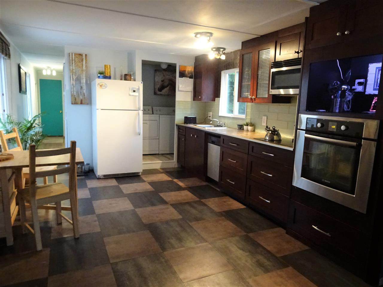"""Main Photo: 15 4200 DEWDNEY TRUNK Road in Coquitlam: Ranch Park Manufactured Home for sale in """"HIDEWAY PARK"""" : MLS®# R2124110"""