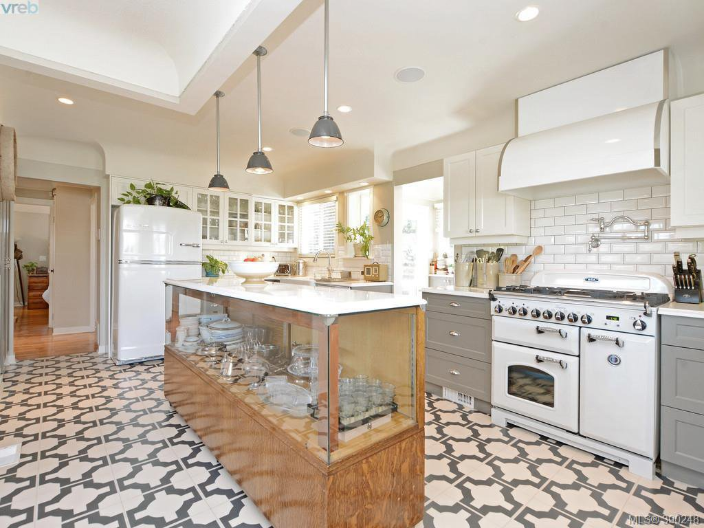 Absolutely STUNNING kitchen with 6 Burner AGA Gas Stove, pot fill tap for convenience, Ventahood rangehood fan, Quartz counters with beveled edges, High end KitchenAid Fridge & Dishwasher with 'Big Chill' coverplates give a cool retro vibe! Designer floor