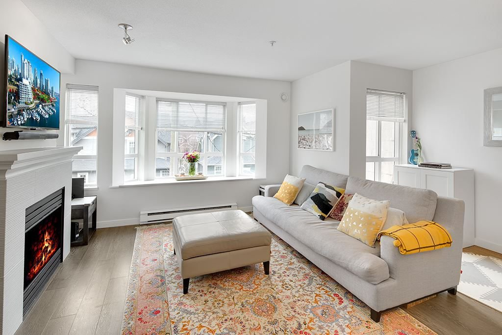 """Main Photo: 209 2545 W BROADWAY in Vancouver: Kitsilano Townhouse for sale in """"TRAFALGAR MEWS"""" (Vancouver West)  : MLS®# R2250630"""