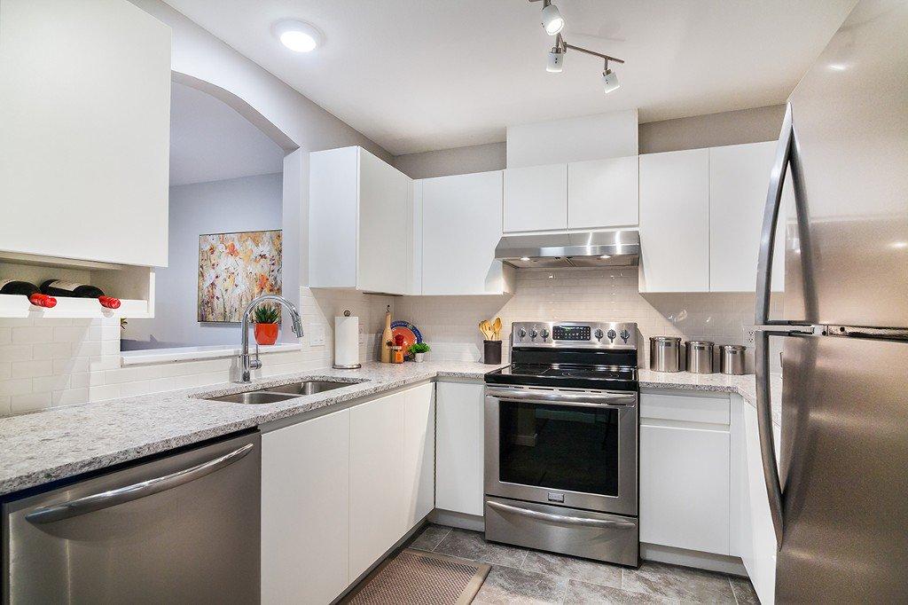 "Main Photo: 110 8180 JONES Road in Richmond: Brighouse South Condo for sale in ""LAGUNA"" : MLS®# R2165281"