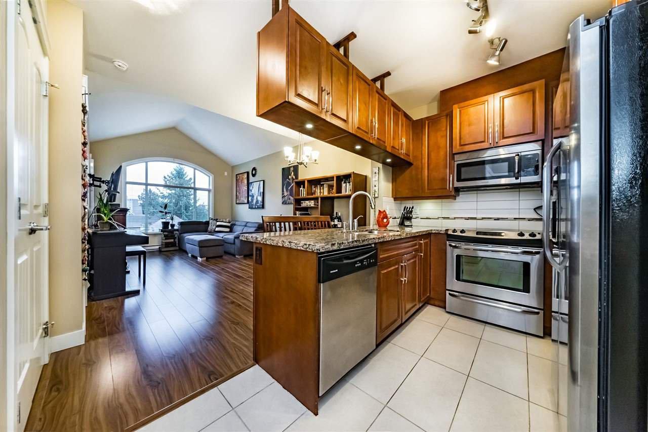 """Main Photo: 403 12525 190A Street in Pitt Meadows: Mid Meadows Condo for sale in """"CEDAR DOWNS"""" : MLS®# R2311707"""