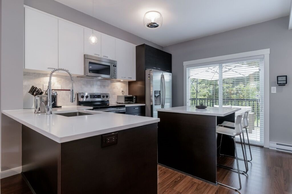 Photo 2: Photos: 122 3010 RIVERBEND Drive in Coquitlam: Coquitlam East Townhouse for sale : MLS®# R2386563