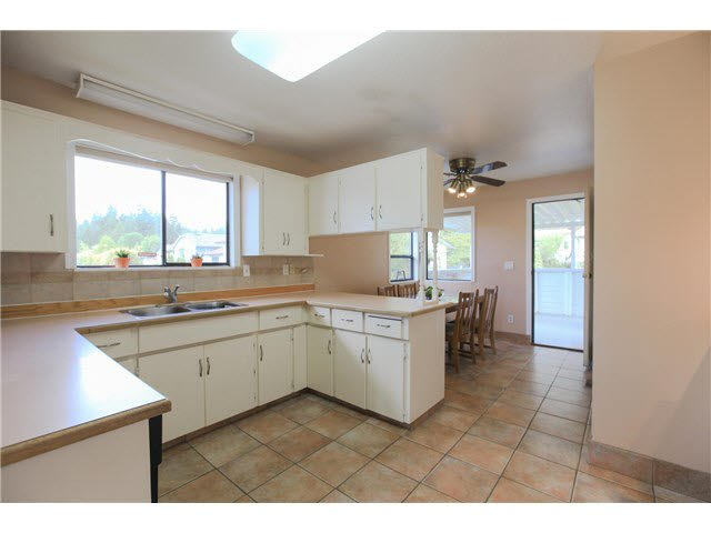 """Photo 5: Photos: 1982 ELIZABETH Drive in Coquitlam: River Springs House for sale in """"RIVER SPRINGS"""" : MLS®# V1142803"""
