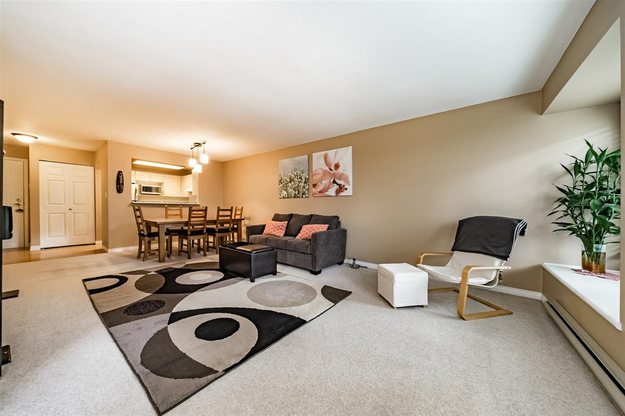 Huge living room & dining room!  Lots of natural light with this south facing suite!