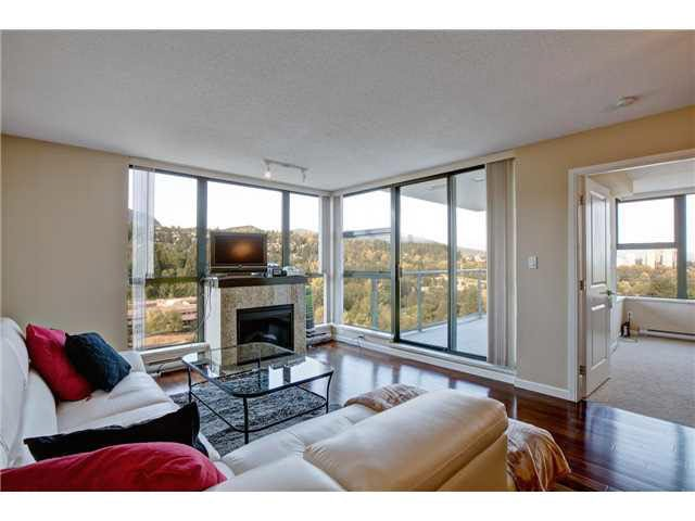 """Corner Unit-Gorgeous Mountain treelined private views. Very open & bright unit with floor to ceiling windows leading to the covered large patio"