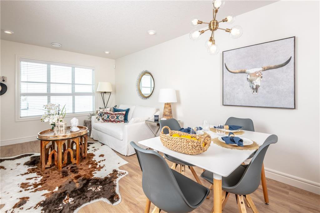 Photo 3: Photos: 409 19621 40 Street SE in Calgary: Seton Apartment for sale : MLS®# C4236548