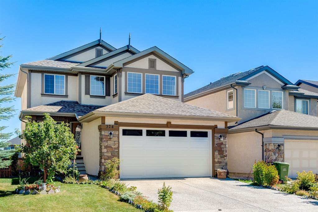 Main Photo: 324 EVERBROOK Way SW in Calgary: Evergreen Detached for sale : MLS®# A1032313