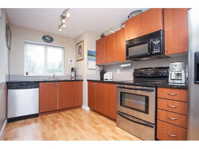 """Photo 4: Photos: 101 3063 IMMEL Street in Abbotsford: Central Abbotsford Condo for sale in """"CLAYBURN RIDGE"""" : MLS®# R2046562"""