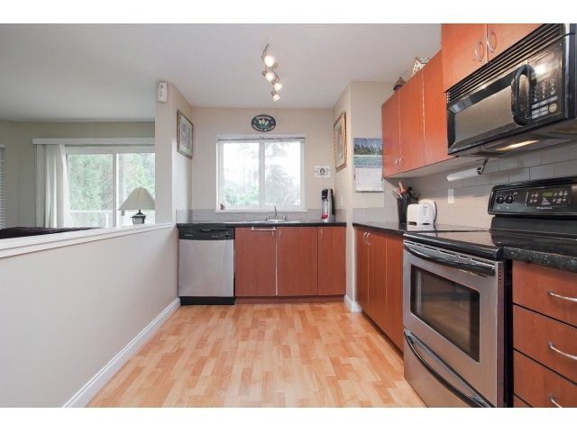 """Photo 3: Photos: 101 3063 IMMEL Street in Abbotsford: Central Abbotsford Condo for sale in """"CLAYBURN RIDGE"""" : MLS®# R2046562"""
