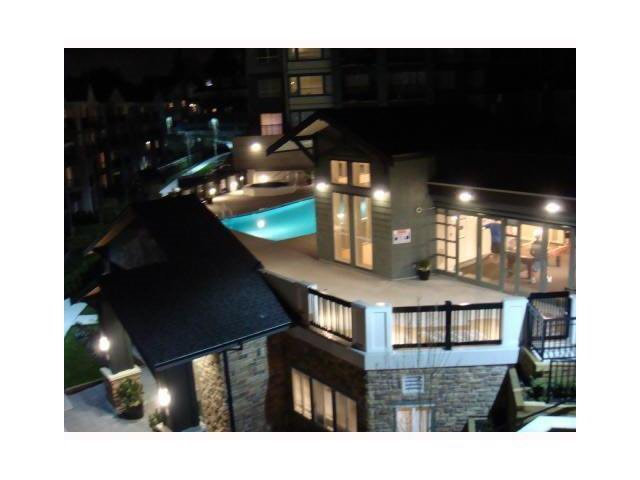 Night photo of pool area and exterior building.