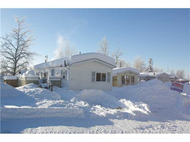 "Main Photo: 22 7414 FOREST LAWN Street in Fort St. John: Fort St. John - Rural E 100th Manufactured Home for sale in ""FOREST LAWN PARK"" (Fort St. John (Zone 60))  : MLS®# N241694"