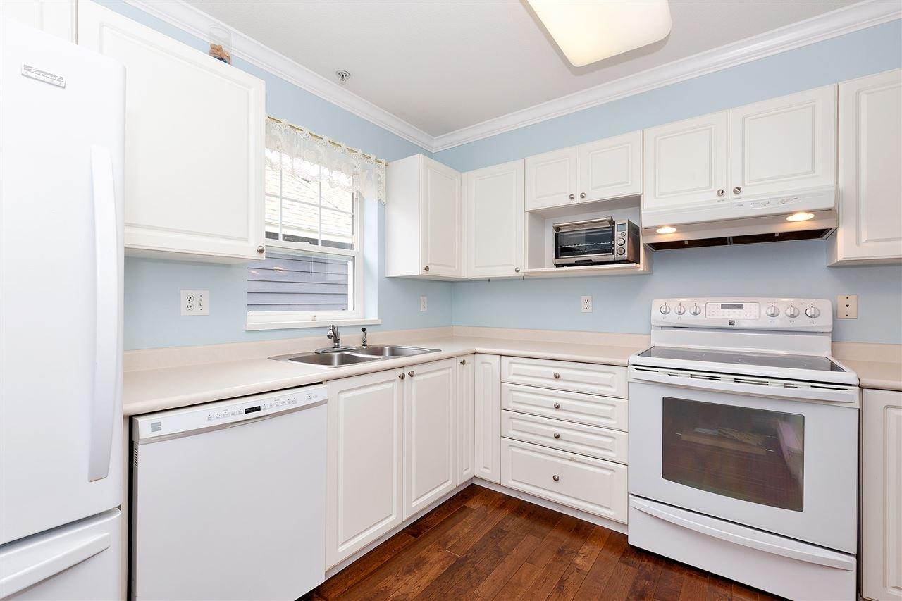 "Main Photo: 410 3085 PRIMROSE Lane in Coquitlam: North Coquitlam Condo for sale in ""LAKESIDE TERRACE"" : MLS®# R2453056"