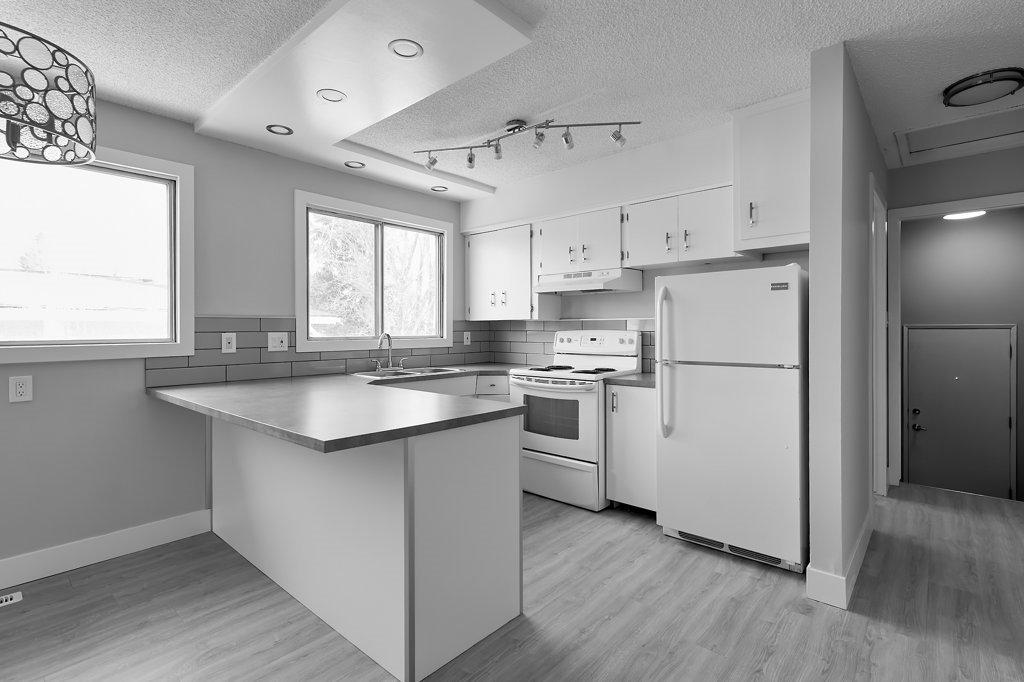 Main Photo: 403 MILLBOURNE Road E in Edmonton: Zone 29 House Half Duplex for sale : MLS®# E4193823