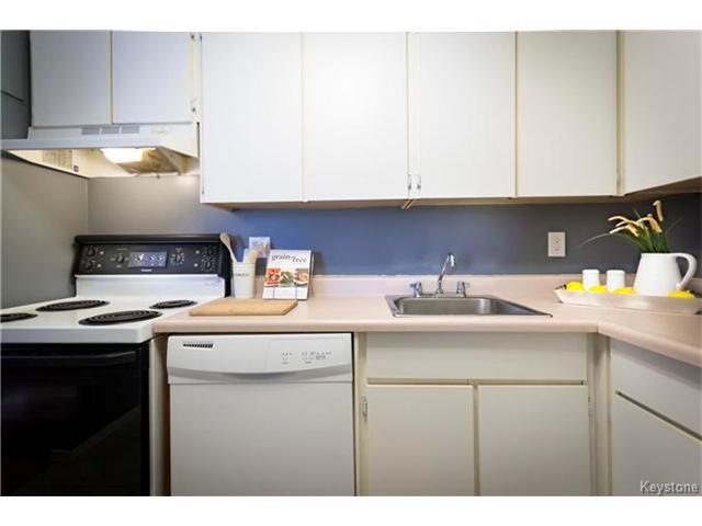 Photo 9: Photos: 460 Kenaston Boulevard in Winnipeg: River Heights Condominium for sale (1D)  : MLS®# 1705140