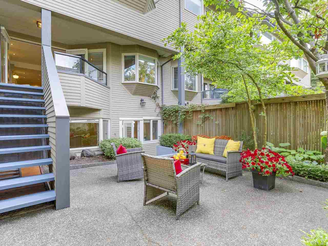 "Main Photo: 2411 W 1ST Avenue in Vancouver: Kitsilano Townhouse for sale in ""Bayside Manor"" (Vancouver West)  : MLS®# R2191405"