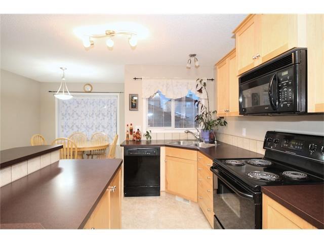 Photo 12: Photos: 824 EVERRIDGE Drive SW in Calgary: Evergreen House for sale : MLS®# C4048320