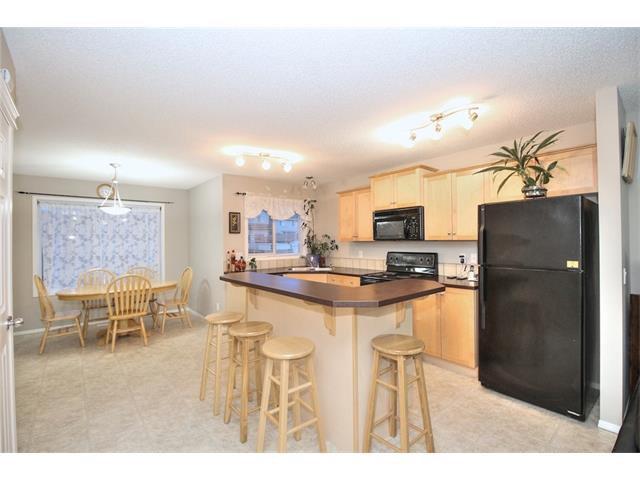 Photo 8: Photos: 824 EVERRIDGE Drive SW in Calgary: Evergreen House for sale : MLS®# C4048320