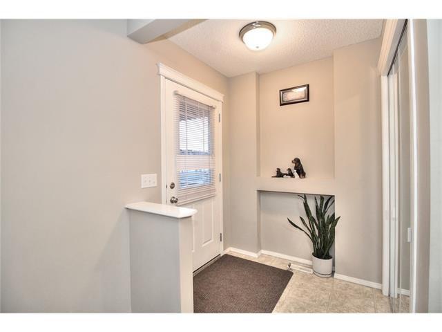 Photo 4: Photos: 824 EVERRIDGE Drive SW in Calgary: Evergreen House for sale : MLS®# C4048320