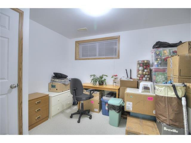 Photo 25: Photos: 824 EVERRIDGE Drive SW in Calgary: Evergreen House for sale : MLS®# C4048320