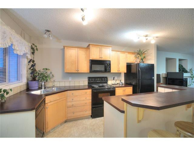 Photo 14: Photos: 824 EVERRIDGE Drive SW in Calgary: Evergreen House for sale : MLS®# C4048320