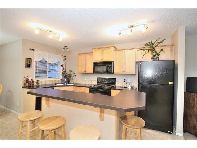 Photo 10: Photos: 824 EVERRIDGE Drive SW in Calgary: Evergreen House for sale : MLS®# C4048320