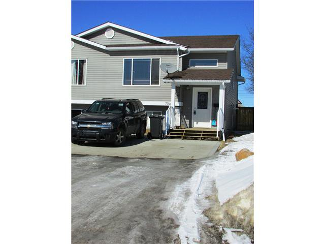 "Main Photo: 7916 97TH Avenue in Fort St. John: Fort St. John - City SE House 1/2 Duplex for sale in ""NORTH ANNEOFIELD"" (Fort St. John (Zone 60))  : MLS®# N234446"