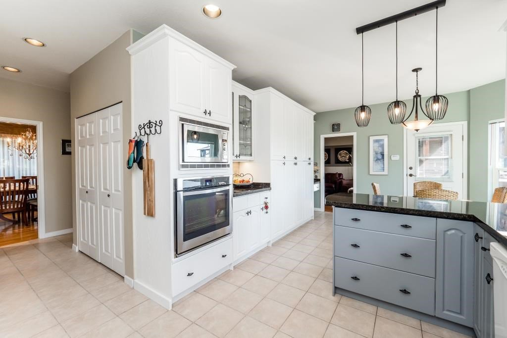Photo 7: Photos: 823 E 6TH Street in North Vancouver: Queensbury House for sale : MLS®# R2107919