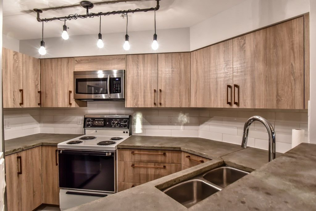 "Photo 3: Photos: 104 2401 HAWTHORNE Avenue in Port Coquitlam: Central Pt Coquitlam Condo for sale in ""STONEBROOK"" : MLS®# R2239669"