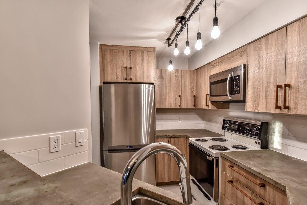 "Photo 2: Photos: 104 2401 HAWTHORNE Avenue in Port Coquitlam: Central Pt Coquitlam Condo for sale in ""STONEBROOK"" : MLS®# R2239669"