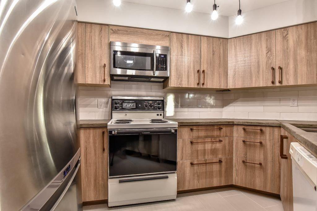 "Photo 5: Photos: 104 2401 HAWTHORNE Avenue in Port Coquitlam: Central Pt Coquitlam Condo for sale in ""STONEBROOK"" : MLS®# R2239669"