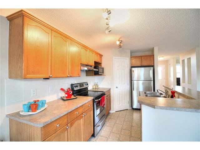 Photo 16: Photos: 606 EVERMEADOW Road SW in Calgary: Evergreen House for sale : MLS®# C4053479