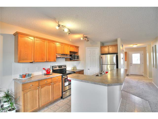 Photo 15: Photos: 606 EVERMEADOW Road SW in Calgary: Evergreen House for sale : MLS®# C4053479