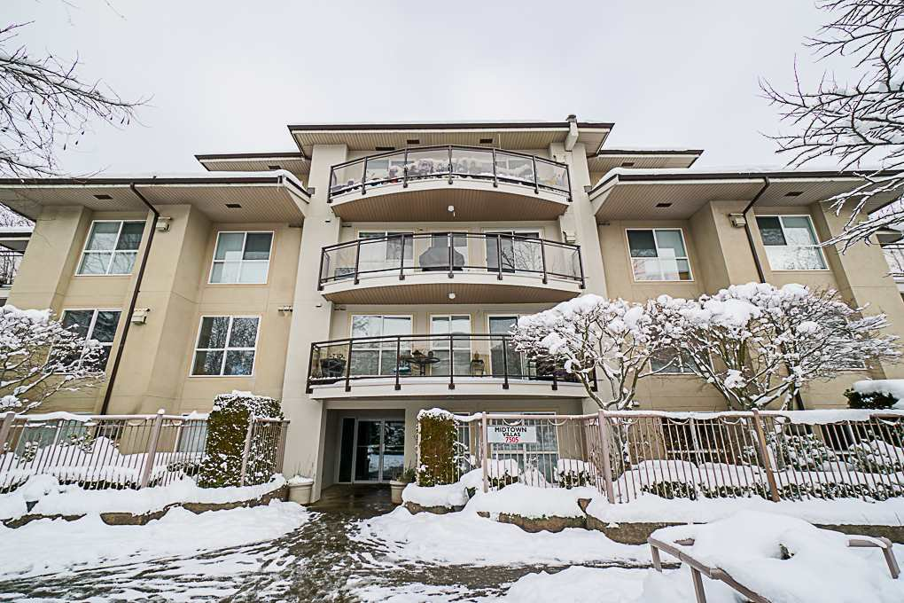"Main Photo: 101 7505 138 Street in Surrey: East Newton Condo for sale in ""Mid Town Villas"" : MLS®# R2339425"
