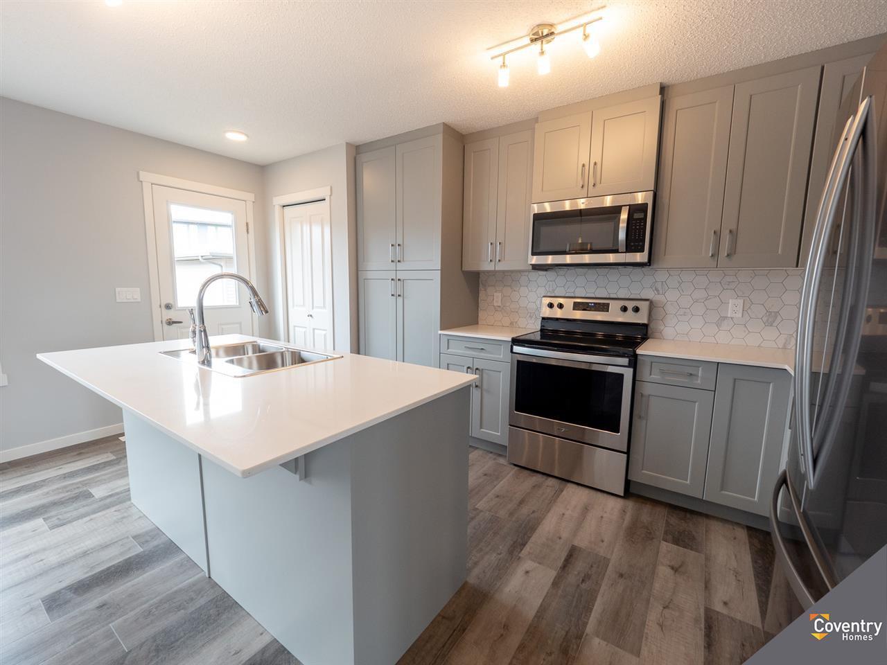 Main Photo: 20124 27 Avenue in Edmonton: Zone 57 Attached Home for sale : MLS®# E4180340
