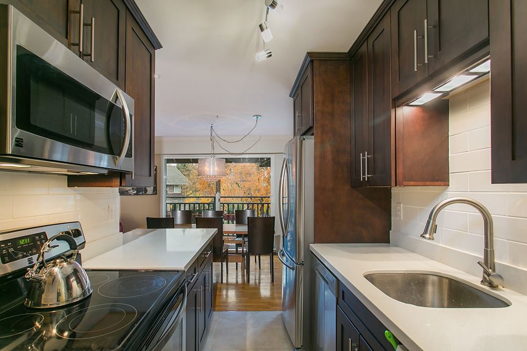 """Main Photo: 1204 555 W 28TH Street in North Vancouver: Upper Lonsdale Townhouse for sale in """"CEDAR BROOKE VILLAGE"""" : MLS®# R2016764"""