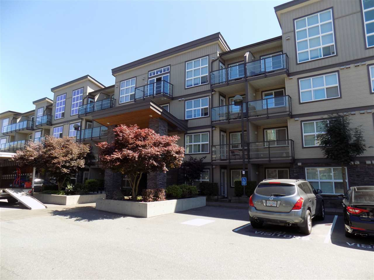"Main Photo: 406 30525 CARDINAL Avenue in Abbotsford: Abbotsford West Condo for sale in ""Tamarind Westside"" : MLS®# R2185961"
