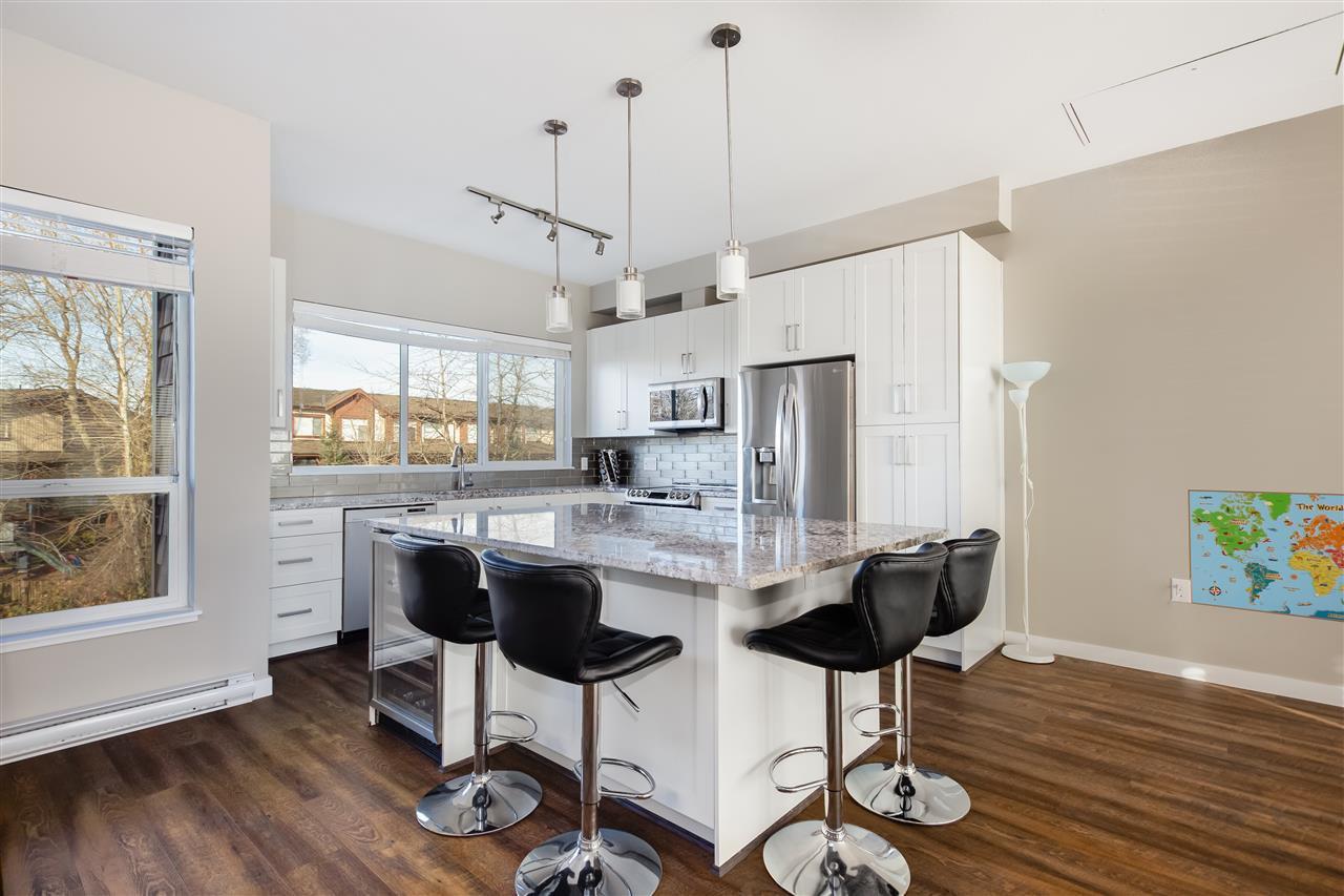 "Main Photo: 411 6470 194 Street in Surrey: Clayton Condo for sale in ""ESPLANADE RIDGE AT WATERSTONE"" (Cloverdale)  : MLS®# R2371275"