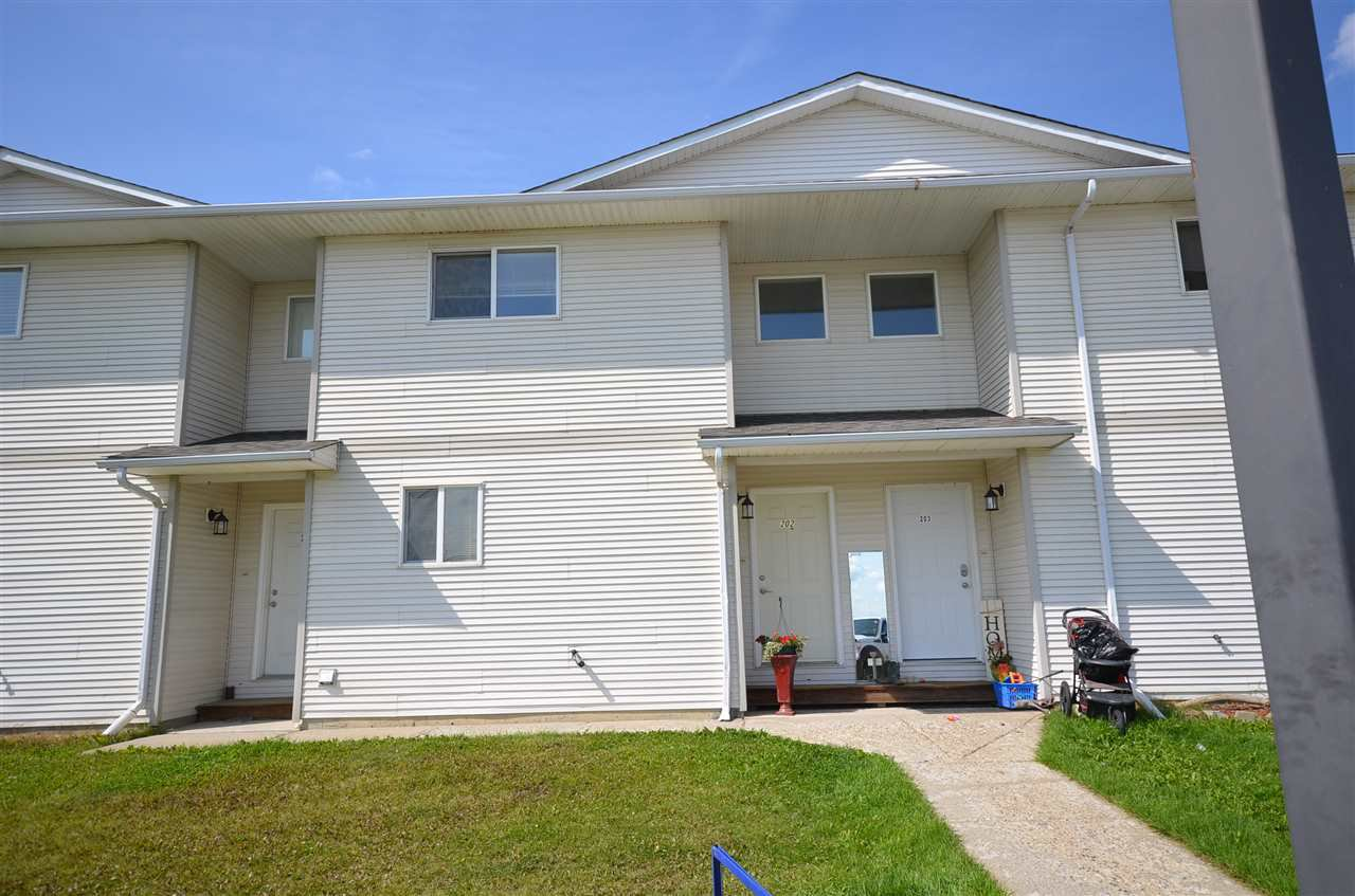 "Main Photo: 202 8220 92 Avenue in Fort St. John: Fort St. John - City SE Townhouse for sale in ""CARLINGTON PLACE"" (Fort St. John (Zone 60))  : MLS®# R2511019"